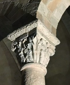 carved column with a floral design