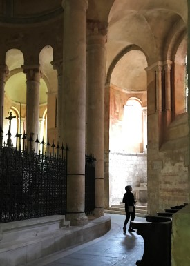 The Romanesque Ambulatory is lit with a sense of mystery of a thousand years of pilgrims